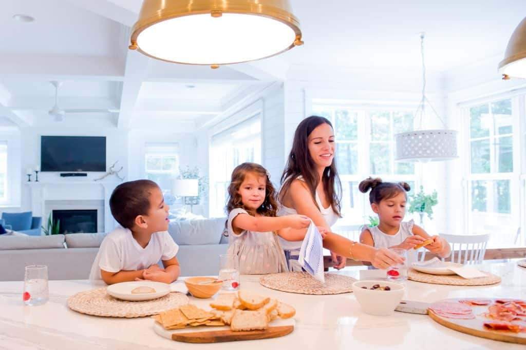 kids and a mom at kitchen island