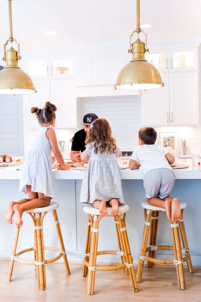 3 kids on counter stools