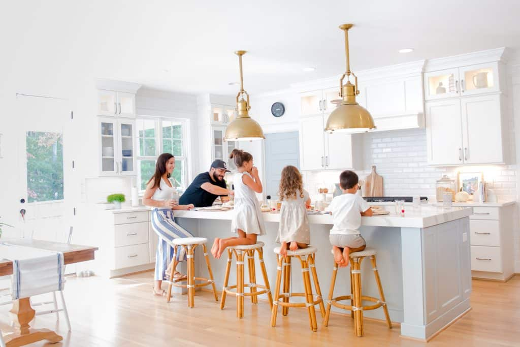 family gathered around kitchen island with 4 kid friendly counter stools
