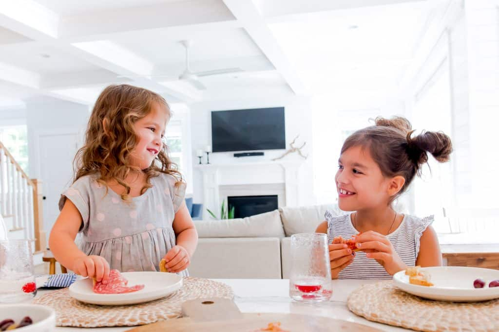 girls smiling and eating