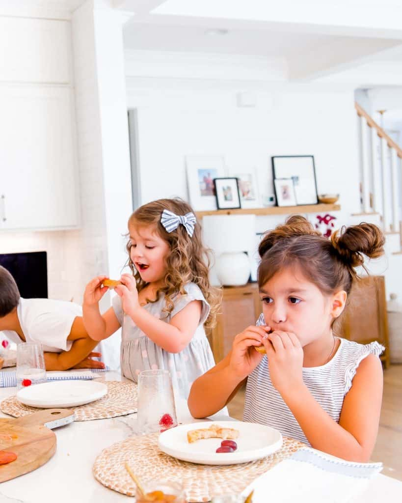girls eating at the kitchen counter