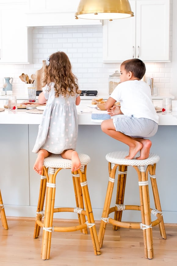kid friendly counter stools with children sitting on them