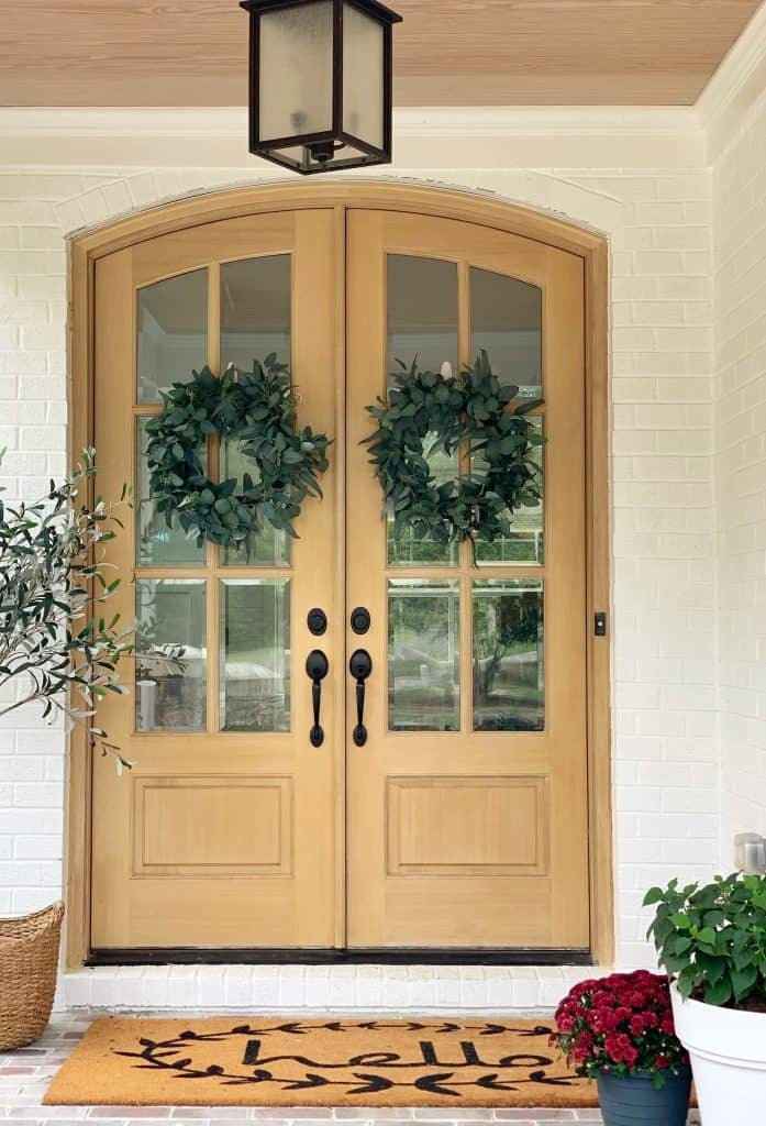wooden double doors on a porch