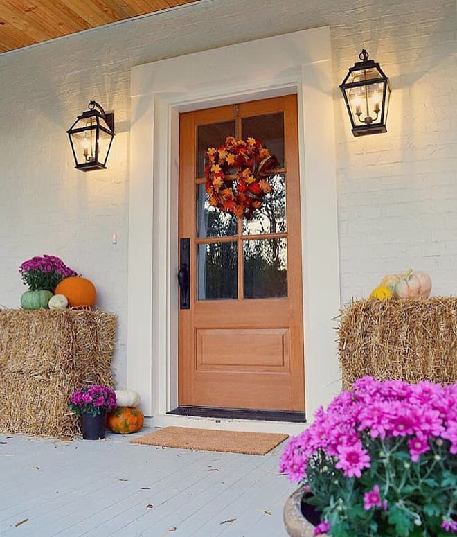beautiful fall porch on instagram with haystacks