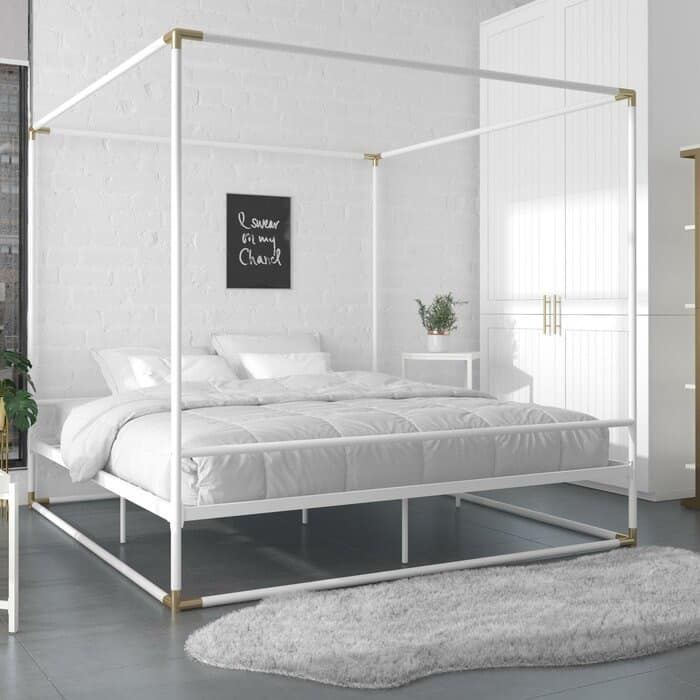 white and brass canopy bed