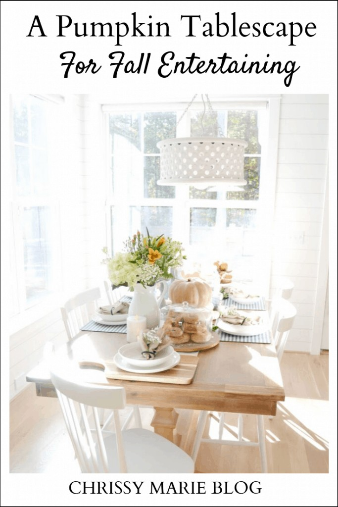 Pinterest image with the text A Pumpkin Tablescape For Fall Entertaining