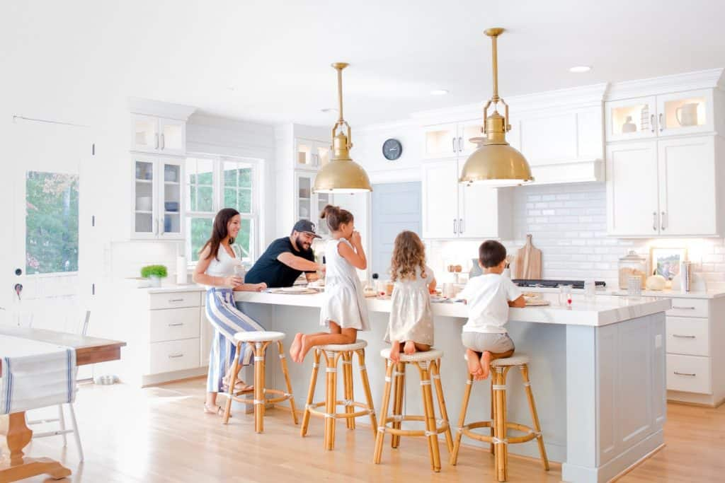 family hanging out around kid friendly counter stools