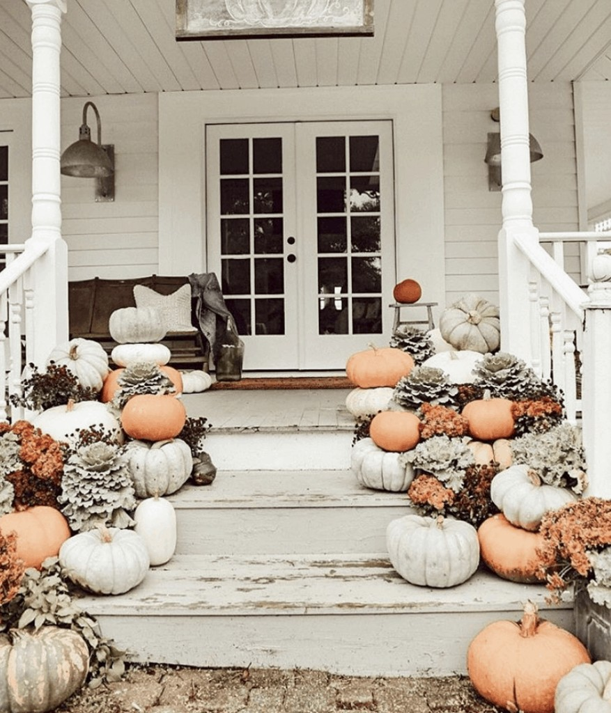 beautiful fall porch on instagram with lots of pumpkins
