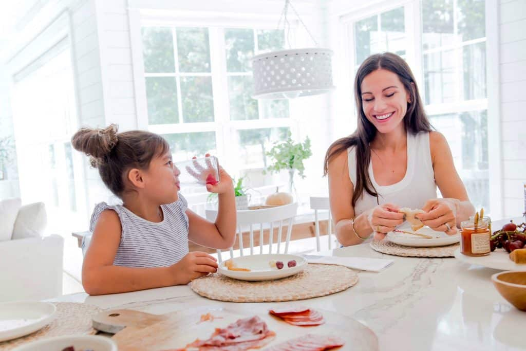 mom and daughter eating happily