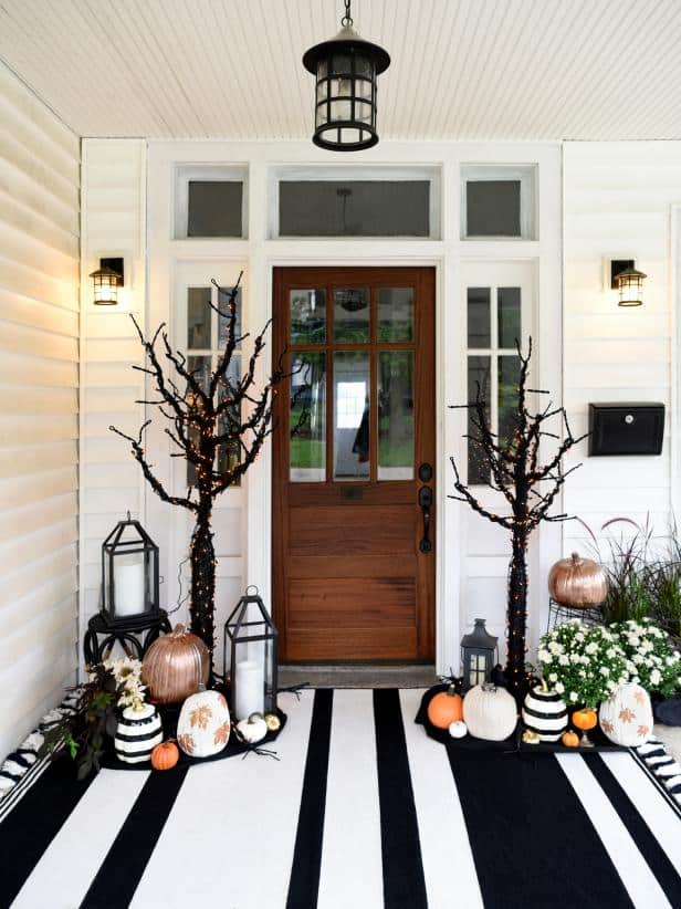 spooky front porch decorated with scary halloween trees