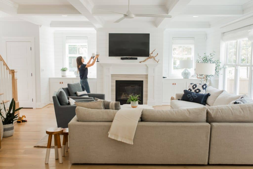 mantel decor with a tv above it in a living room