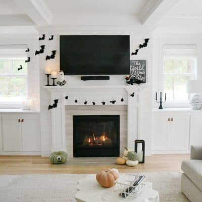 living room with mantel decorated black and white