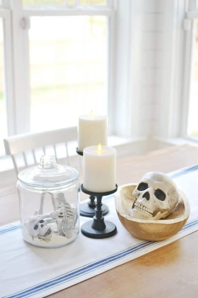 a jar with skeleton bones inside