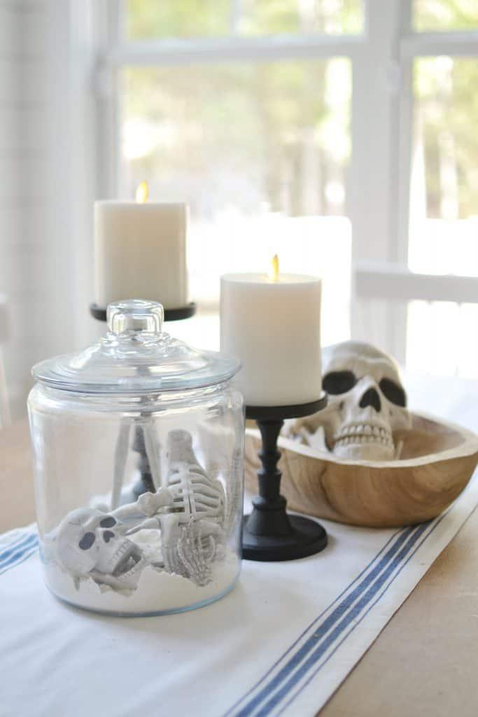 halloween design ideas showing a skeleton bones In a jar