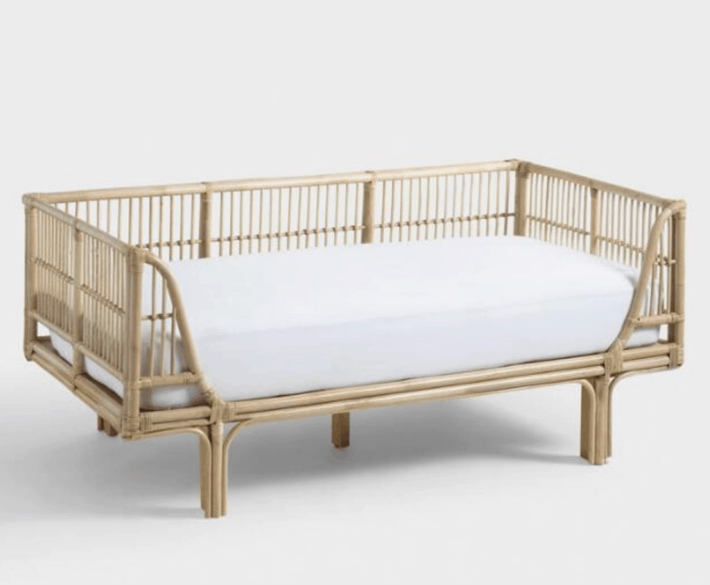 a rattan daybed with a mattress