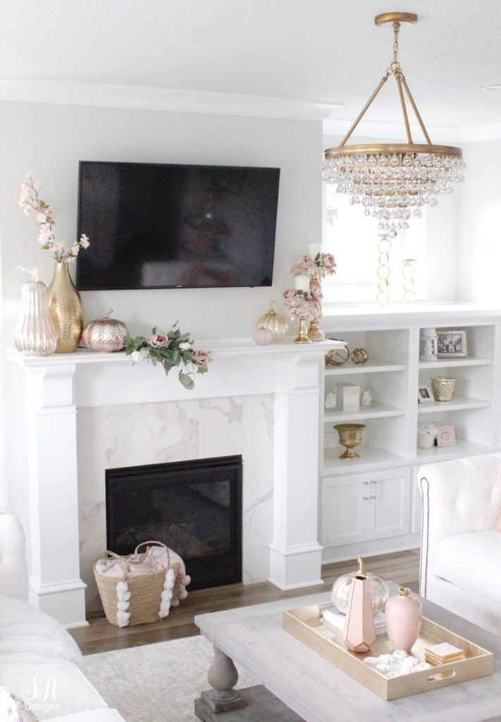 mantel styled with a TV on top