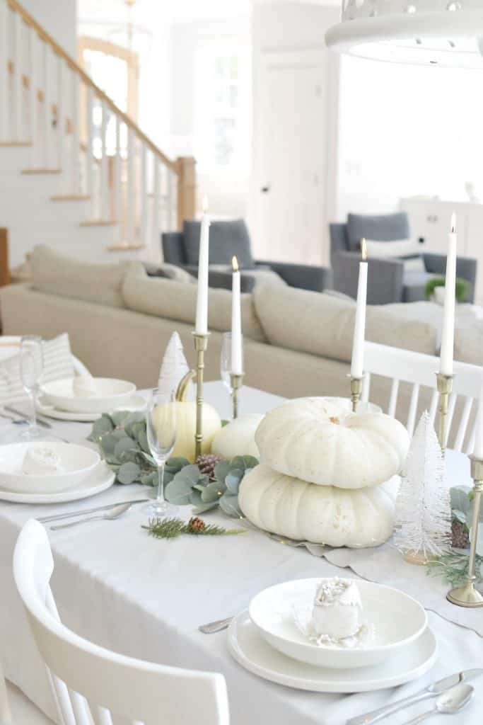 table with candles set for thanksgiving