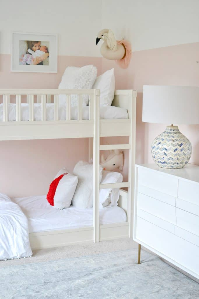 bunk bed with christmas pillow in a girls room