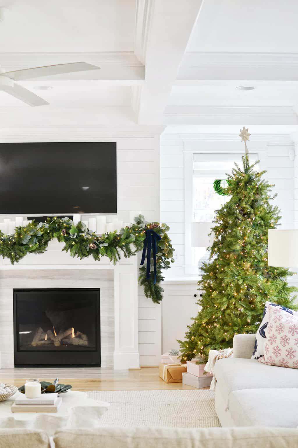 garland above mantle with christmas tree