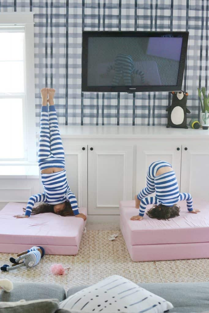 close up of 2 kids doing handstands