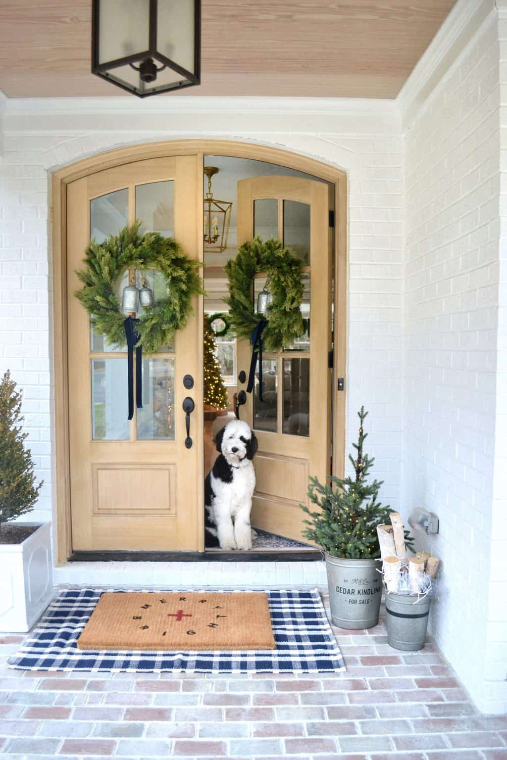 front porch Christmas decorations with a dog