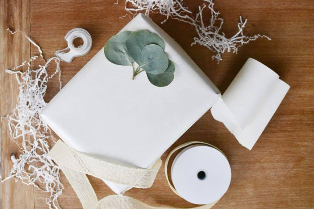 white box wrapped up with eucalyptus leaf on the outside