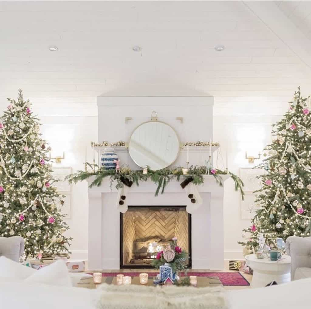 two giant christmas trees in living room