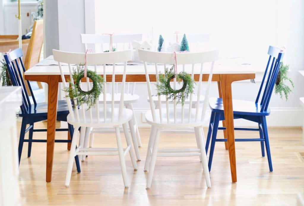white chairs with christmas wreaths on them