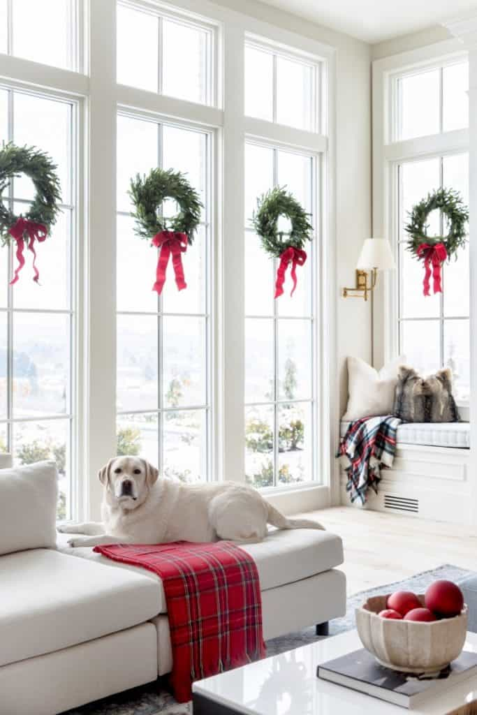 wreaths on interior windows with ribbon