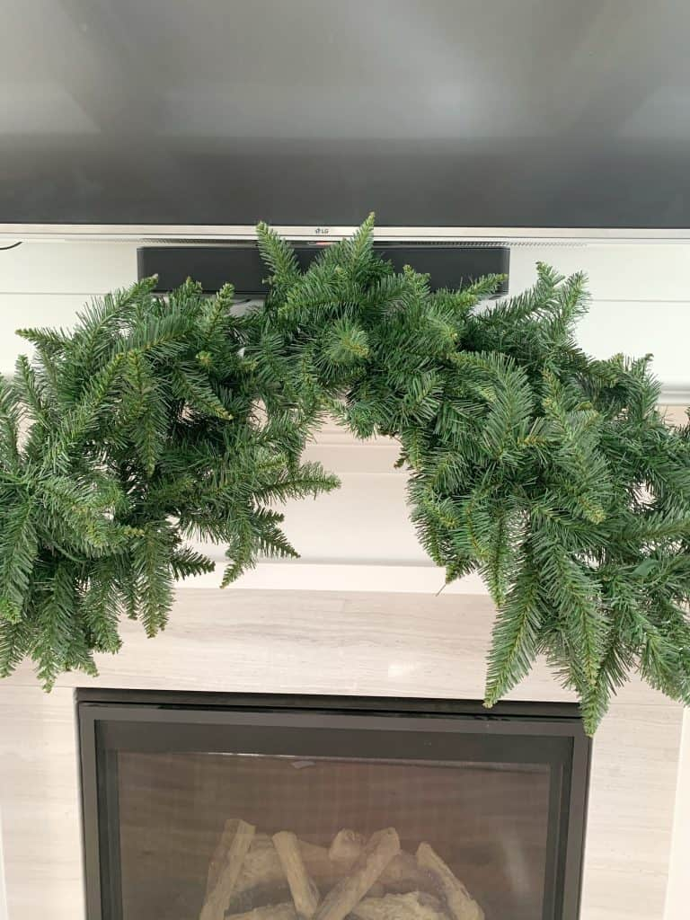 close up of faux garland on mantle