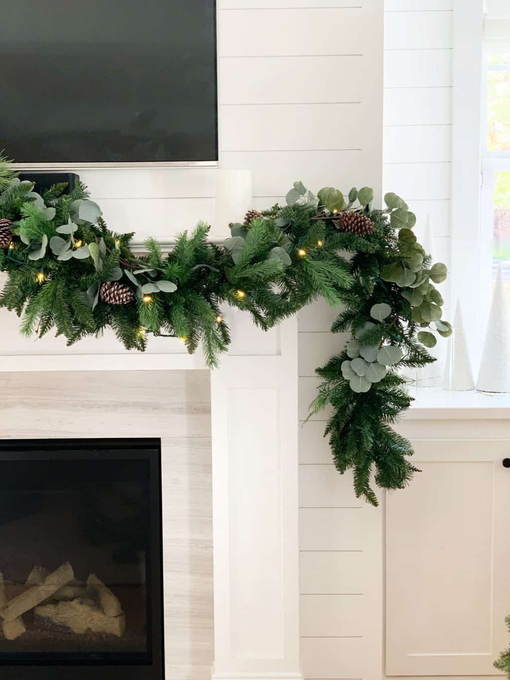 eucalyptus garland hanging on mantle