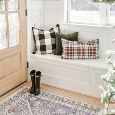 holiday pillows on a bench from pottery barn