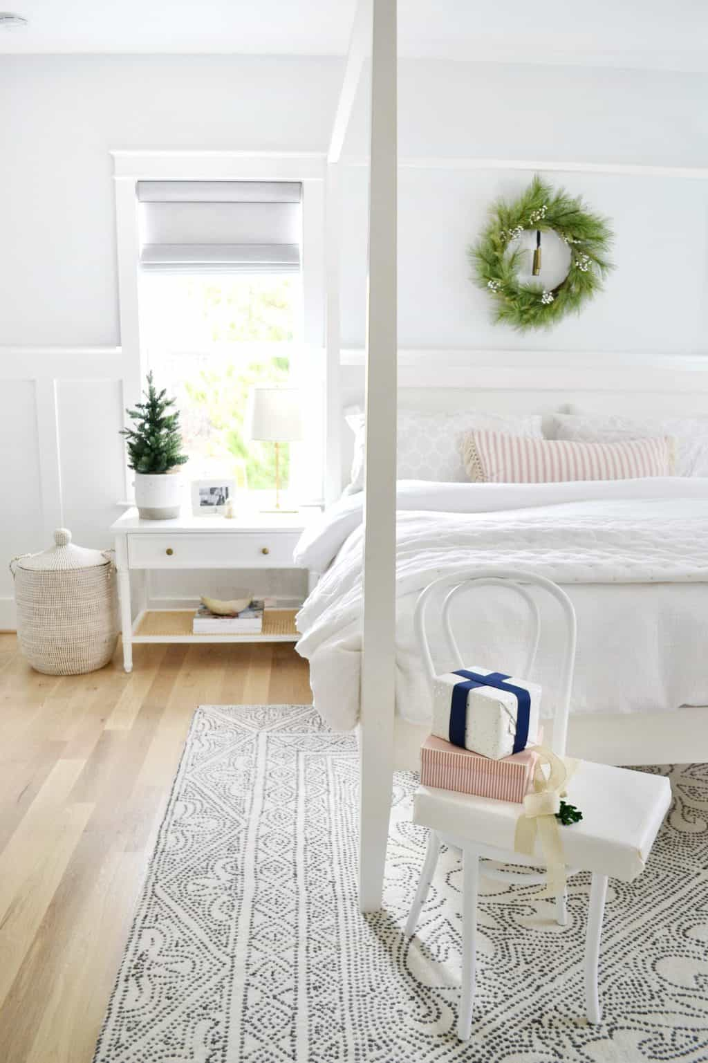 chair in a bedroom with christmas presents