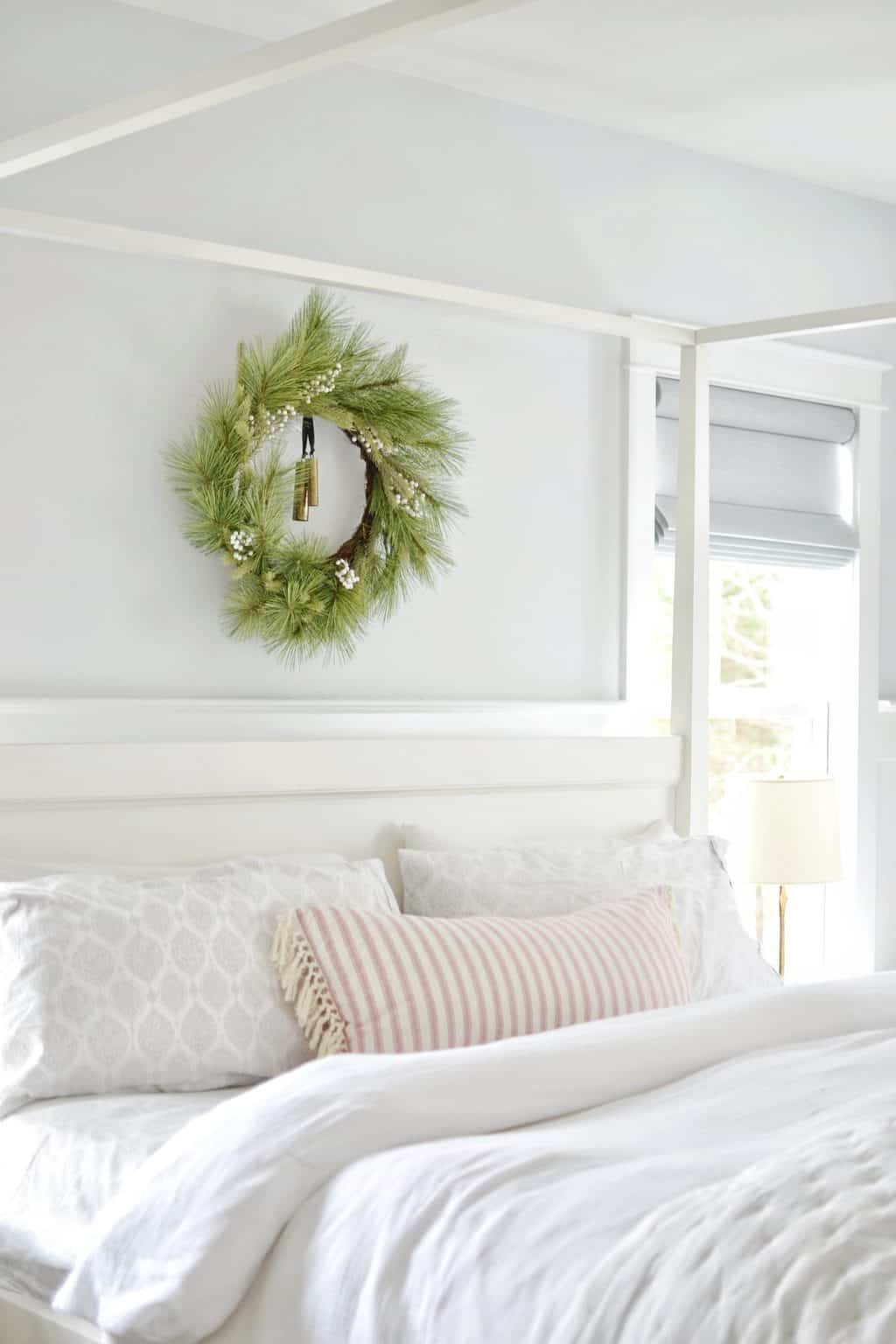 christmas wreath above bed in a bedroom