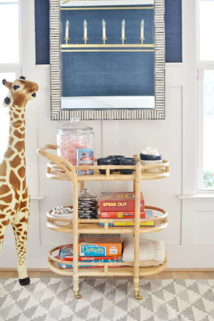 bar cart styled with games and hot cocoa
