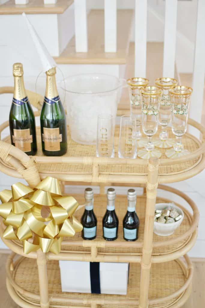 bar cart with gold glasses