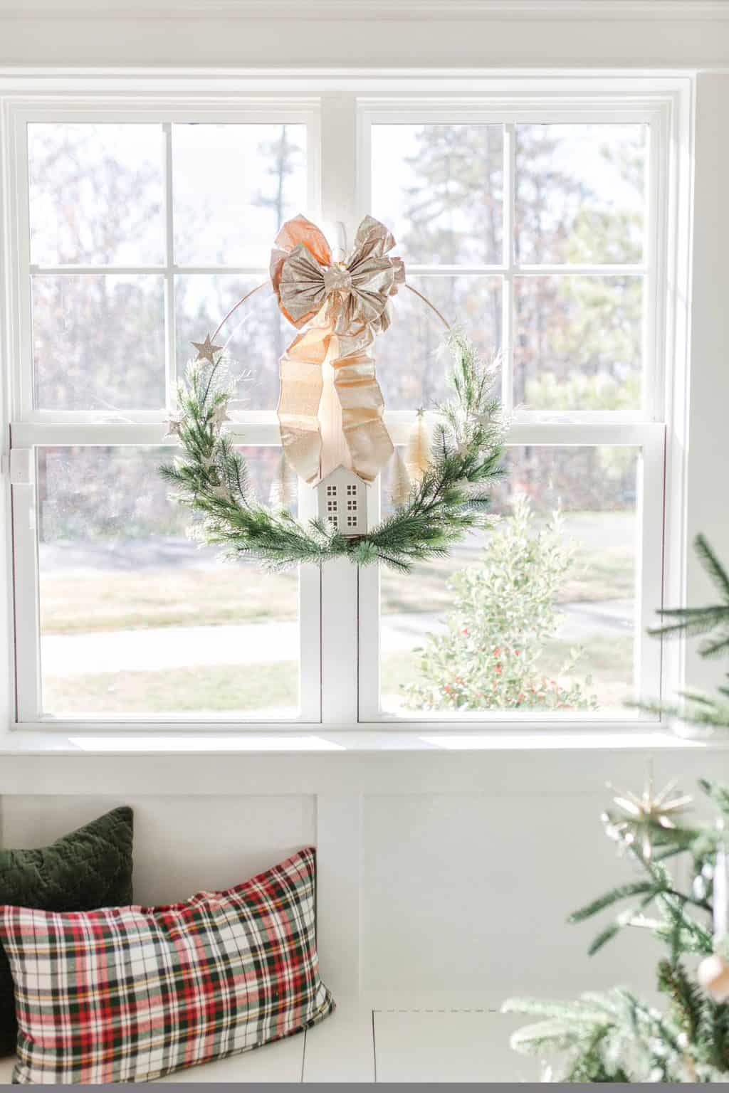 christmas home tour with a wreath in the window