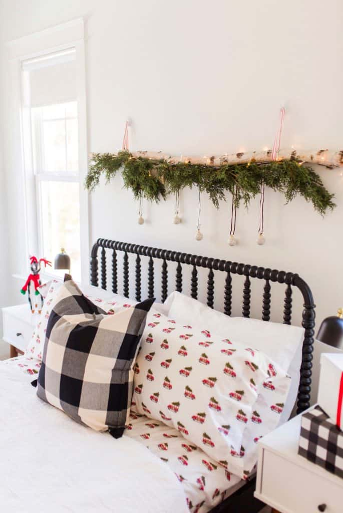 birch log wall hanging for christmas above bed