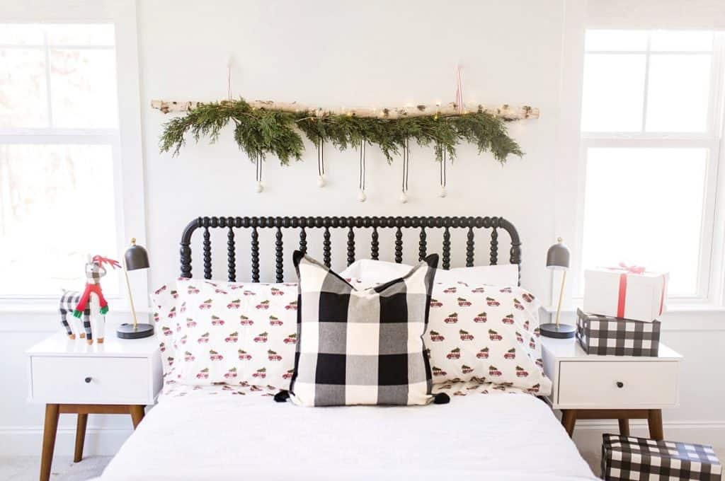birch log christmas decor above bed