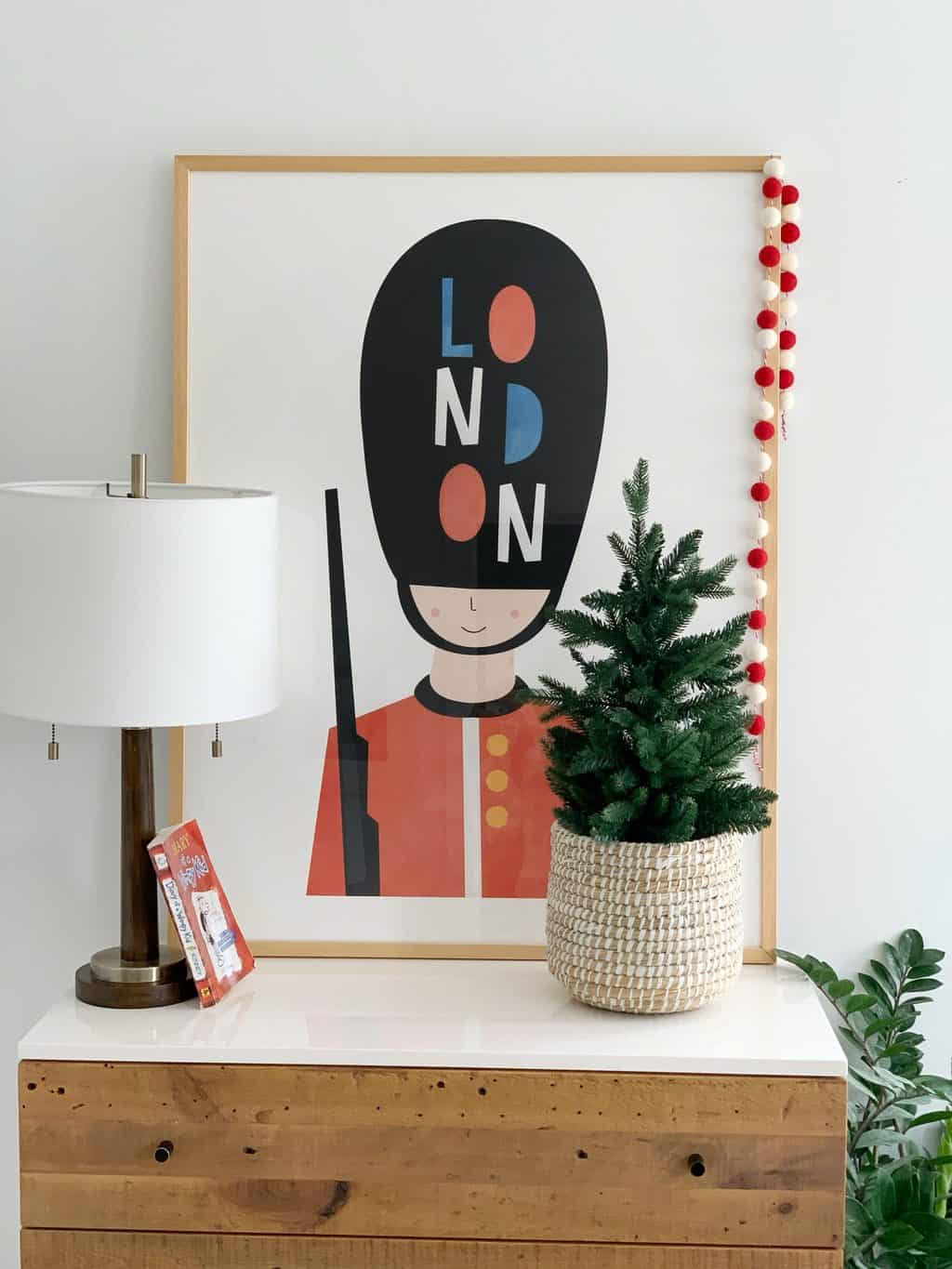Christmas plant and garland on a bedroom dresser