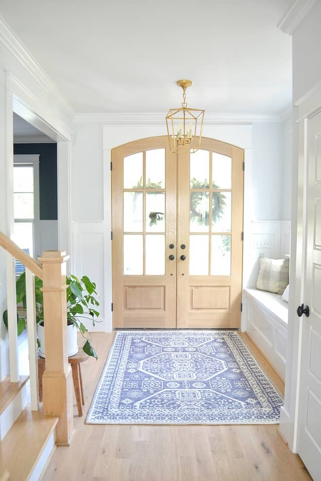foyer with glass front doors and white oak hardwood flooring