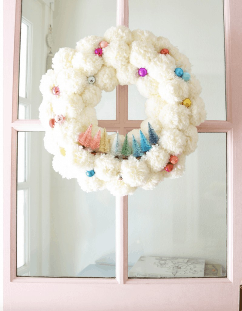 white wreath with colorful trees on it