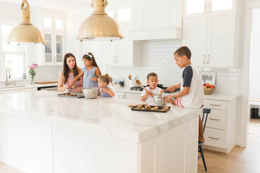 top kitchen trends 2020, a family baking in an all white kitchen