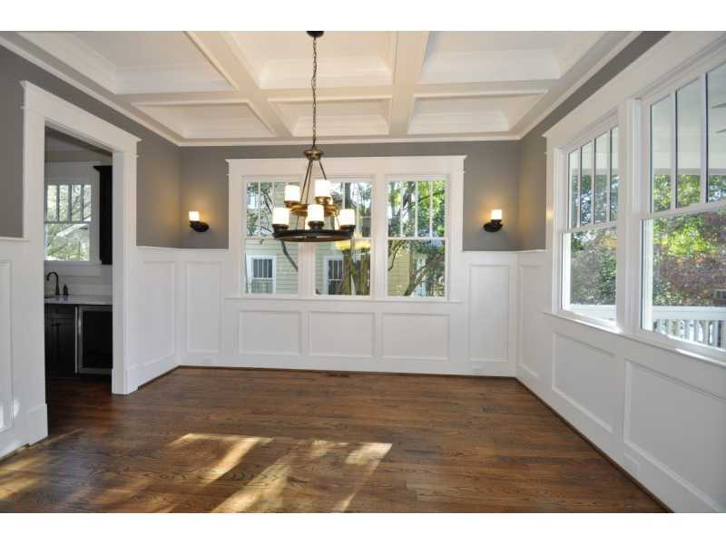 empty dining room with coffered ceiling