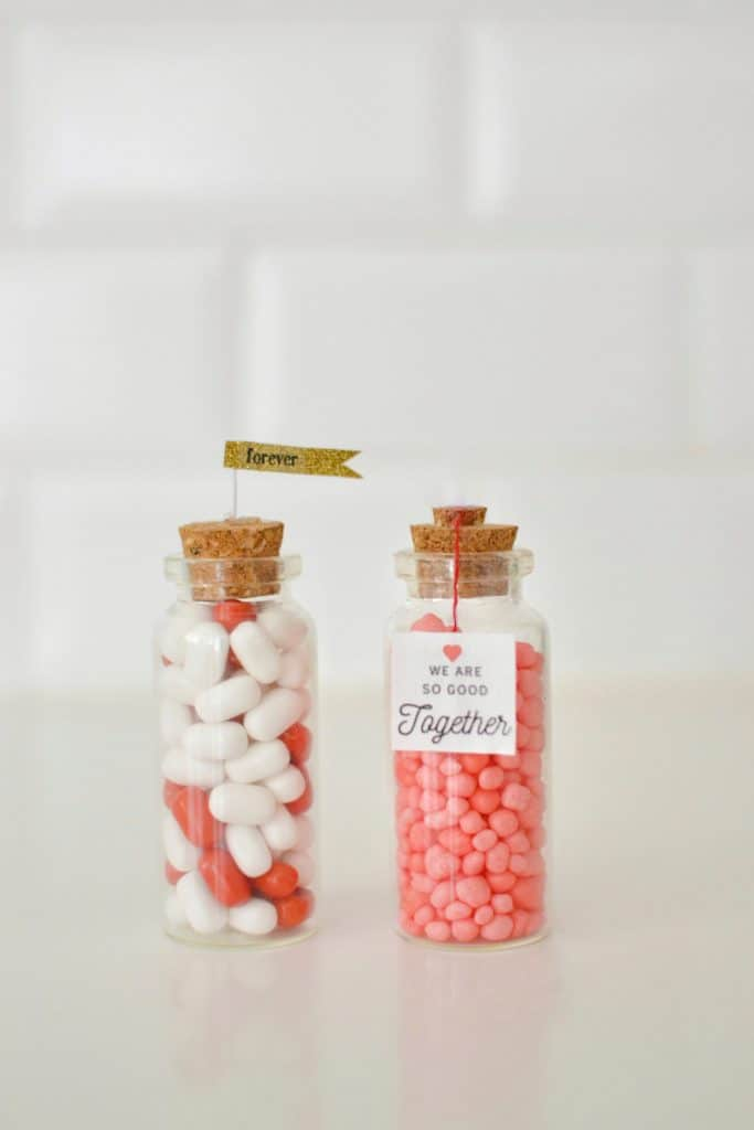 2 mini valentine jars filled with candy