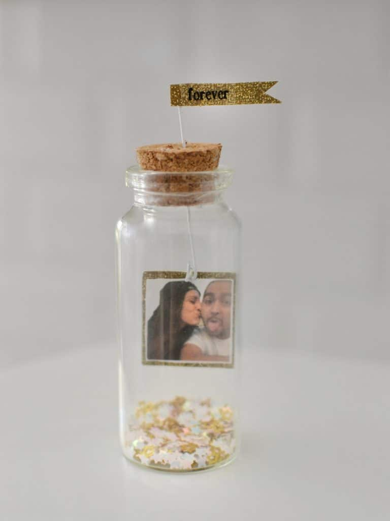 a photo in a tiny bottle