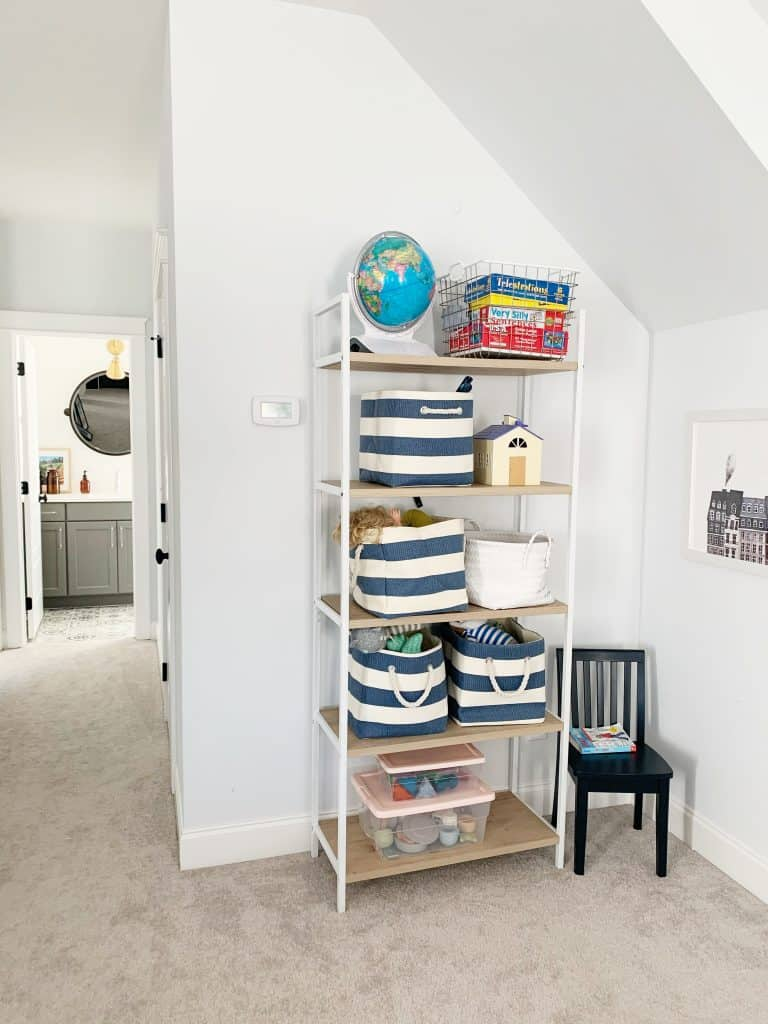 wall with bookshelf and blue stripes around the cube baskets