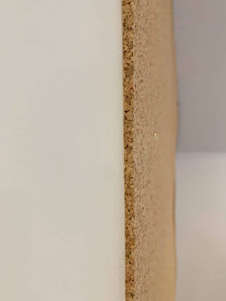 the edge of a cork board wall