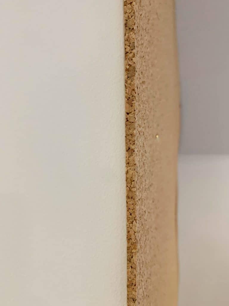 the edge of a cork board wall