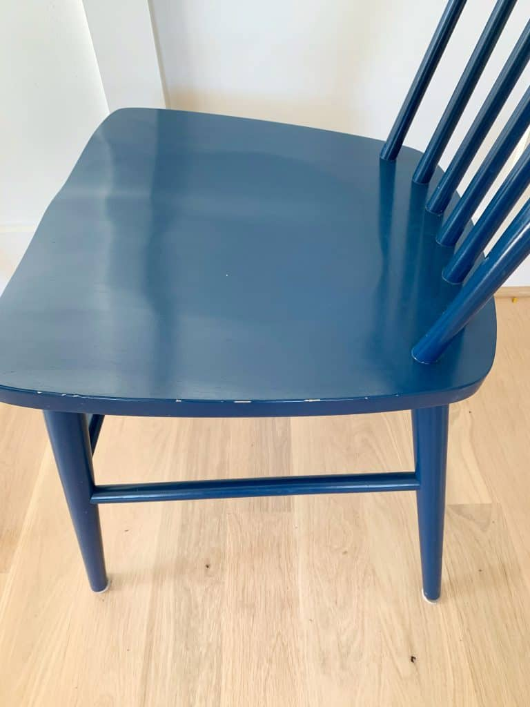 navy target dining chair close up with scrapes